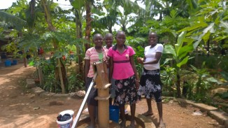 Girls from the orphanage getting water at the well.