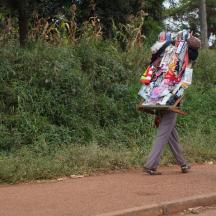 Many people walk up and down the road selling their wares to the backed up traffic!