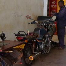 You can see the man's sewing machine. He makes seat covers for motorcycles.